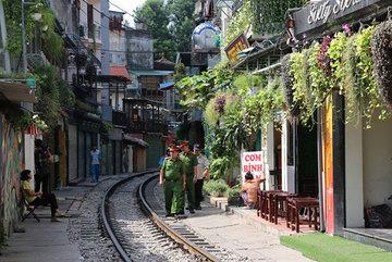 No hope for popular train street's cafés to resume