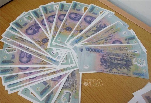 Vietnam Central Bank calls for counterfeit cash vigilance