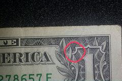 Con nhện trên tờ 1 USD và những biểu tượng bí ẩn trên tiền tệ thế giới