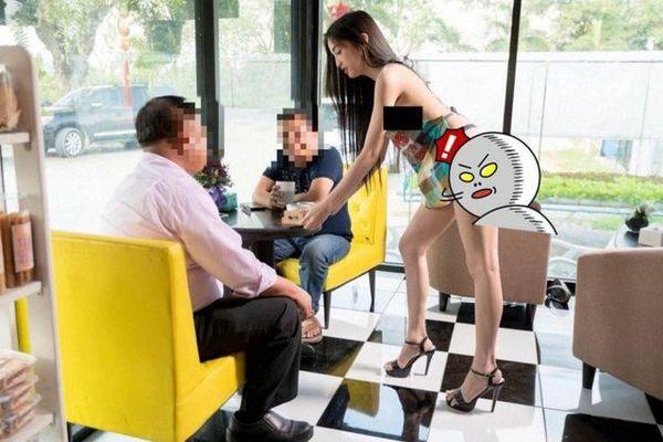 Nữ phục vụ chỉ mặc nội y và tạp dề tiếp khách, nhà hàng nổi sóng
