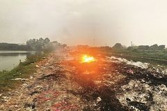 Air pollution in Hanoi worsens as residents burn straw, fabrics