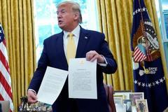 Ông Trump ký thoả thuận giai đoạn một với TQ
