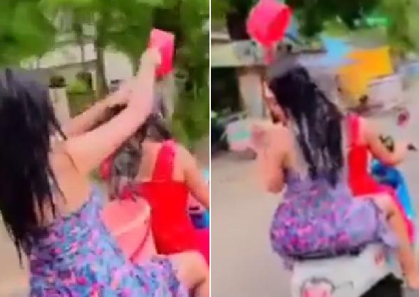 Bất bình 2 cô gái vừa đi xe máy vừa múc nước gội đầu