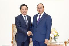 Thủ tướng đề nghị Chính phủ Lào thúc đẩy tháo gỡ khó khăn cho DN Việt Nam