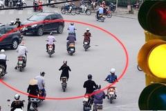 Đi xe máy vượt đèn vàng bị phạt 1 triệu, cách nào để không bị oan?