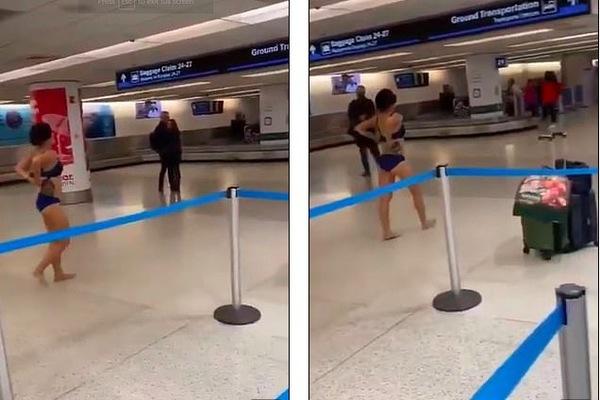 Một phụ nữ bất ngờ thoát y giữa sân bay