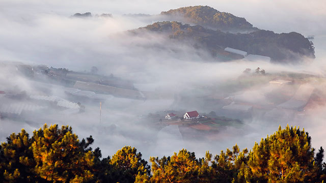 Mountain town in the fog
