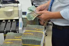 Dân nhận tiền Tết, ngân hàng lập tức giảm lãi suất