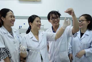 Female scientist interested in rice varieties