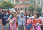 Locals, tourists receives free masks in HCM City