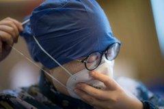 Ngành y tế TQ vùng dịch 'oằn mình' chống virus corona