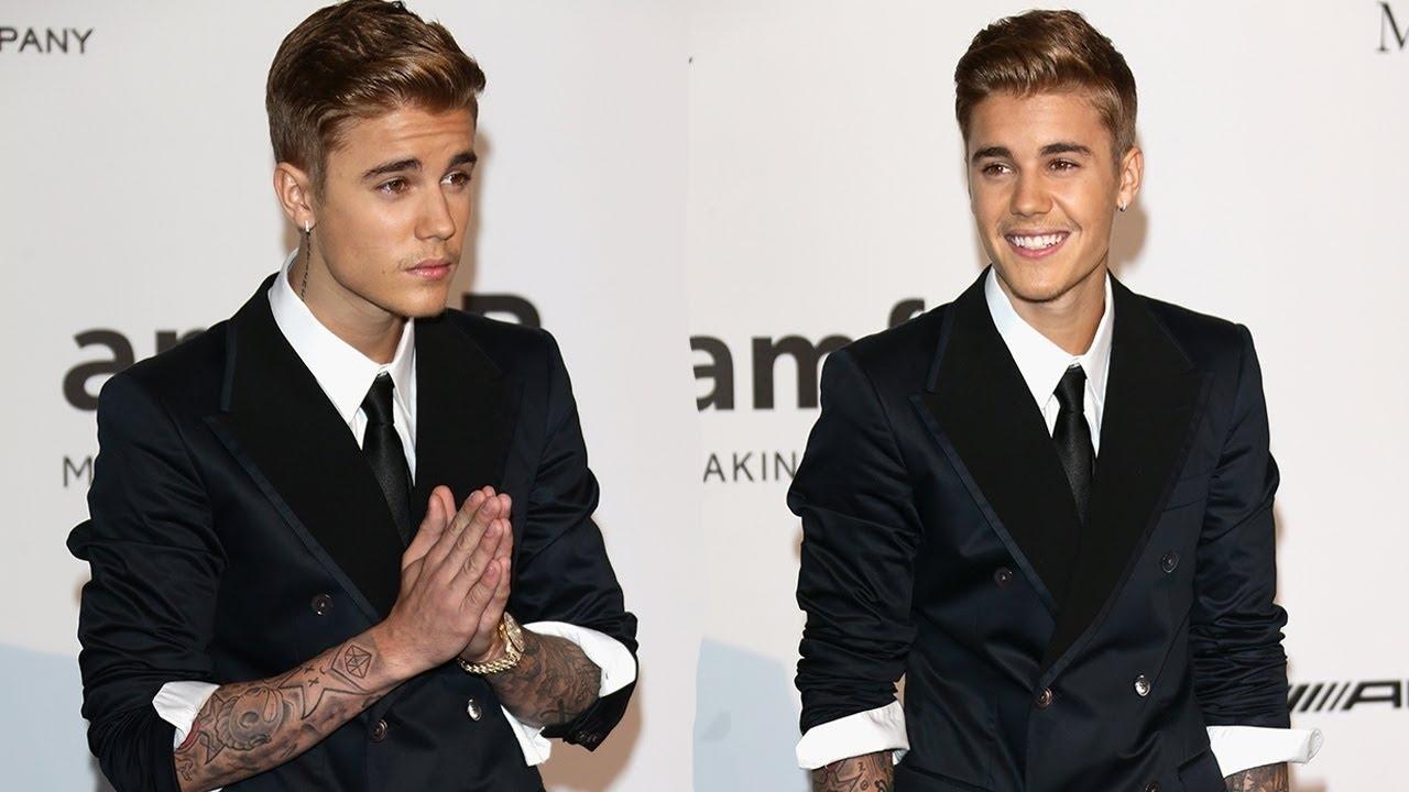 Justin Bieber ăn mặc lôi thôi, tóc rối bù xù đối lập vợ sành điệu trên phố