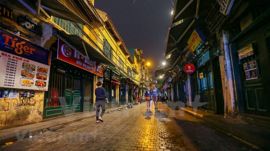 Ta Hien street desolated after suspension order