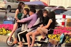 Bất chấp đại dịch Covid-19, công tử Trung Quốc kẹp 5 thiếu nữ trên xe