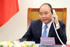 Thủ tướng Việt - Trung điện đàm về hợp tác chống đại dịch