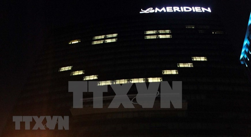 HCM City's buildings lit up to show support for COVID-19 fight