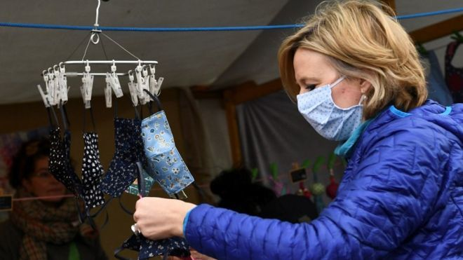 Coronavirus: Germans don compulsory masks as lockdown eases