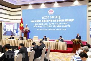 PM Phuc tells Vietnam to restart the economy