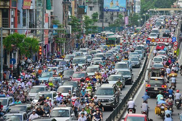 Vietnam's traffic problem,light on,motorbike manufacturers,LED technology,reducing traffic accidents,polluting emissions