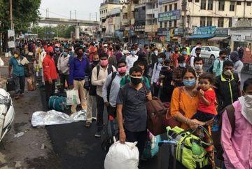India coronavirus: Huge crowds as train services resume