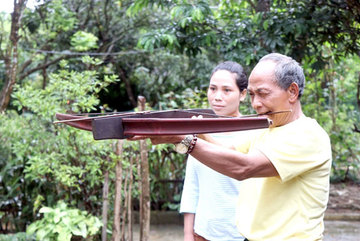 Elderly villager still a dab hand with the crossbow