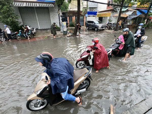HCM City,street flooding,big decrease,improve the life of people