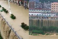 Nước lụt biến cây cầu thành thác nước ấn tượng