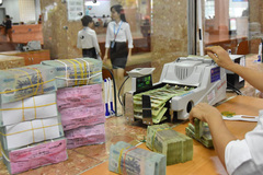 Bad debts return, bank profits fall