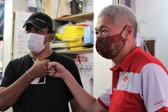 Coronavirus in Singapore: Election campaigning without the handshakes