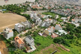 Real estate firms spend trillions of VND to buy land plots
