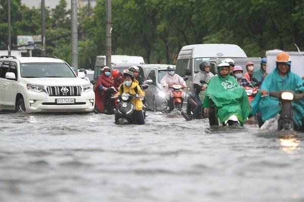 HCM City's many flood-prevention programs still not solving problems
