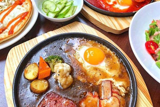 Try a meal in a frying panin HCM City