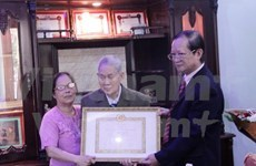 First Vietnamese in Laos honoured with 70-year Party membership insignia