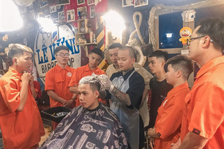Barbers trimthe cost of hair cuts for people in Mekong Delta