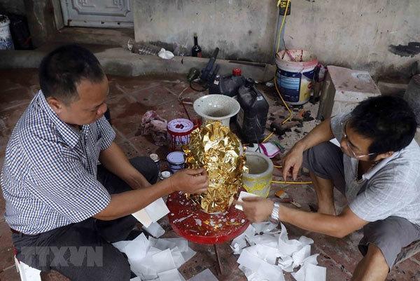 Gold laminating,Kieu Ky Village,handicraft villages