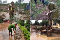 Công an dầm mưa nhổ sắn, dọn bùn giúp dân vùng lũ