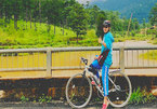 Female cyclist on trans-Vietnam route