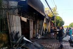 Cửa hàng bốc cháy trong đêm, người đi đường đập cửa báo chủ nhà