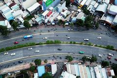 """Nâng cấp đường Nguyễn Hữu Cảnh, người dân lo nhà thành """"rốn ngập"""" mới"""