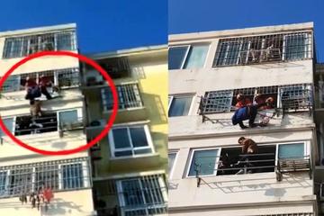 Người hàng xóm liều mình cứu cậu bé bị treo phía ngoài ban công
