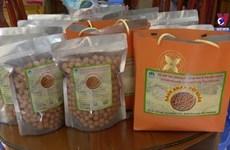 Longan-shaped snack making village busy ahead Tet festival