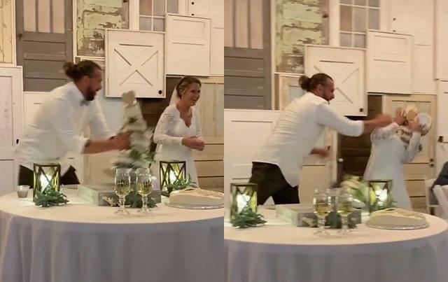 Chú rể 'quá trớn' ném cả chiếc bánh 3 tầng vào mặt cô dâu