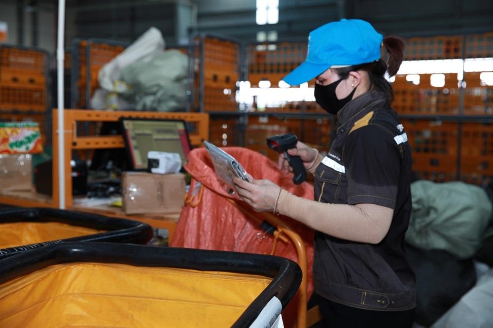 Bưu điện tăng ca, đảm bảo bưu gửi phát trước Tết Nguyên đán