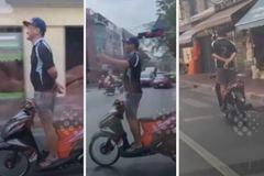 Thanh niên chạy xe tay ga thả hai tay gây chú ý