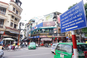 How will Hanoi relocate 215,000 people in four inner city districts?