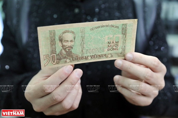 Young man with a passion for collecting old currency