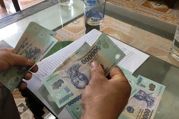 Công an tạm giữ tiền Tết 14 hộ nghèo ở Nghệ An phục vụ điều tra