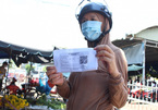 Residents of DaNang beginusing coupons with QR codes for shopping