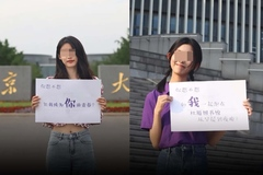 Bức ảnh nữ sinh cổ vũ sĩ tử thi đại học gây tranh cãi ở Trung Quốc