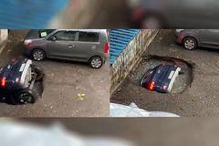 Hãi hùng cảnh ô tô bị nuốt chửng xuống hố trong bãi đỗ xe